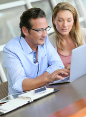 Business people working together on laptop computer