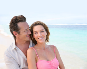 Portrait of loving middle-aged couple at the beach