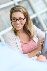 Woman in business meeting using tablet