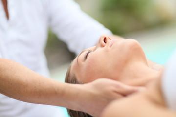Closeup of woman receiving face massage