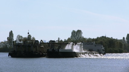 industrial ship on  river extracts sand. PAL clip