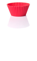 Red silicone cupcake baking cups over white background