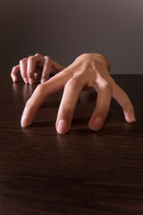 closeup on female hands on wooden table.