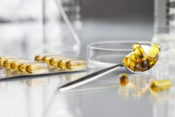 spoon vitamins pills omega 3 supplements blister petri dish