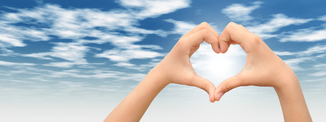 Conceptual heart made of hands banner
