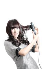 woman joyful with her hair straightener