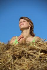 peasant girl resting in haystack