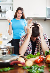Upset man against angry girl at  kitchen