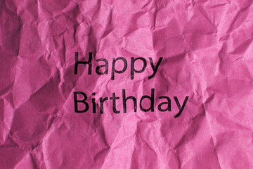 happy birthday text on pink paper