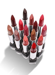 Group of colorful lipsticks isolated on white background