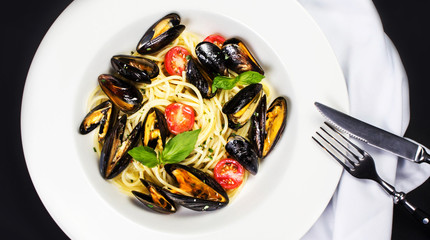 Gourmet Shellfish with fresh italian pasta, cherry tomato and he