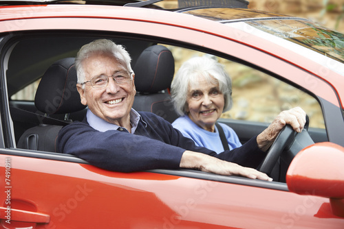 Fototapeta Portrait Of Smiling Senior Couple Out For Drive In Car