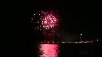 Colorful fireworks over the sea at night in Barcelona
