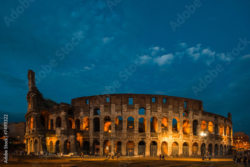 Poszter Colosseum at night in Rome, Italy