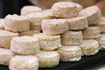 mature small goat cheese at the cheese monger