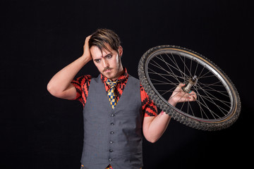 Young man with bike wheel