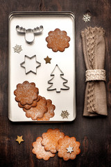 Gingerbread cookies and cookies cutters. Christmas baking.