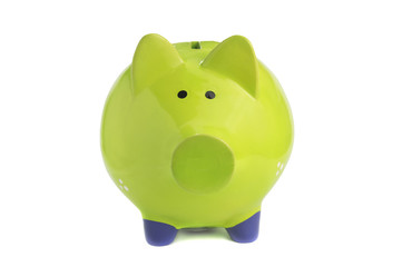 close up of green piggy bank isolated over white