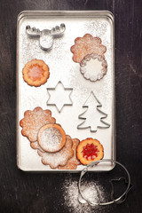 Christmas cookies and cutters. Christmas baking background