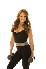 woman in black body suit hold weights smile