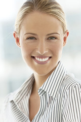 Portrait of a smiling blond hair young woman