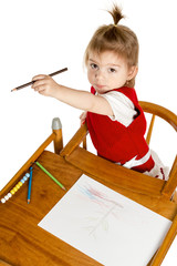 Little girl drawing showing a pencil