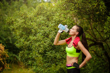 Portrait of sporty young brunette having fitness fun outdoors.