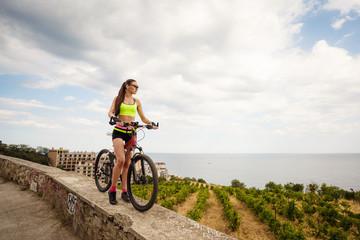 A beautiful woman on the bike