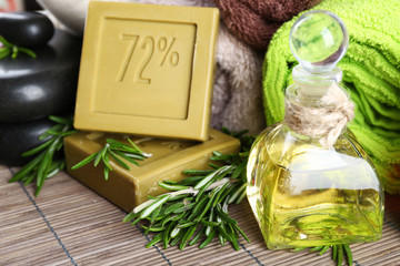 Handmade soap with the branches of rosemary, bottle with