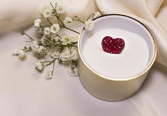 Red heart in a jeweler casket