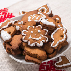 Plate of cookies in the shape of Christmas decorations