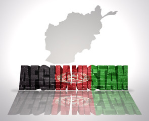 Word Afghanistan on a map background