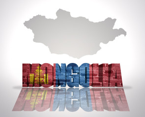 Word Mongolia on a map background