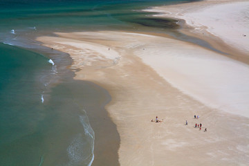 People on Maghara strand in Donegal, Ireland.