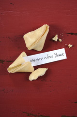Happy New Year message inside Chinese fortune cookie.