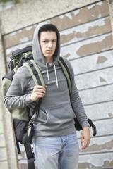 Homeless Teenage Boy On Street With Rucksack
