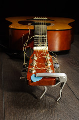 Low angle view of six strings acoustic guitar