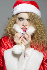 beautiful girl with mascara on the eyes and Christmas Toys