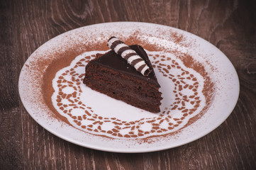 Chocolate cake slice on white plate