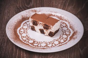 tiramisu dessert slice on white plate