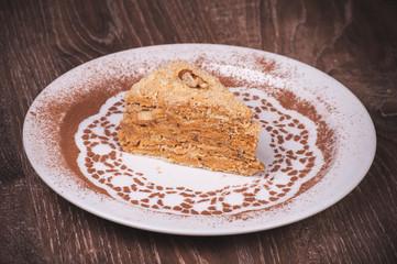 Nut cake slice with honey