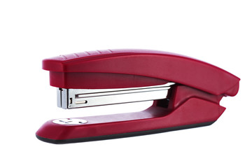 Red stapler isolated on white background