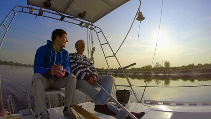 Couple of men yachting on river, friendship, hobby, tourism