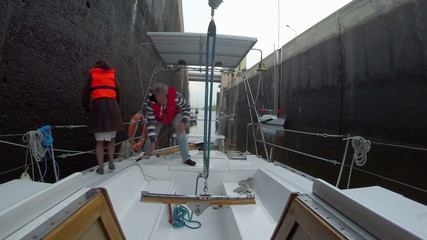 Captain working on boat deck, giving orders to crew, yachting