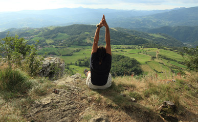 yoga at the top of a  peak