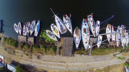Aerial of many sailboats in small harbor, yacht maintenance