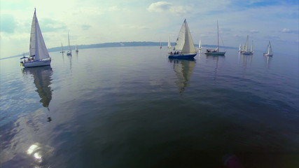 Yachts in open sea, calm, no wind. Sports, recreation, tourism