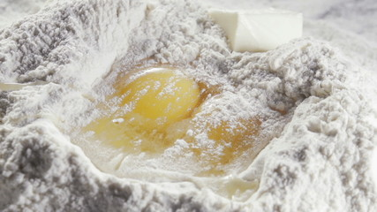 Two eggs in the middle of bleached wheat flour