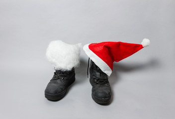 boots with white felt and christmas hat