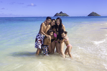mom and kids at beach